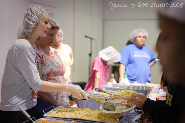 Lindsey serving Thankgiving dinner at soup kitchen