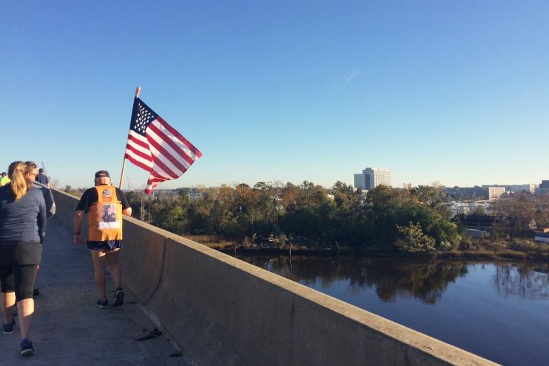 flag runner retired Navy man