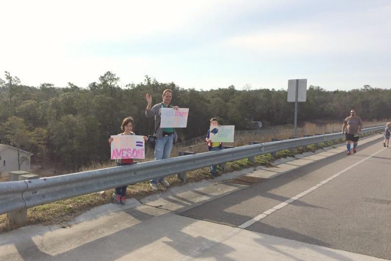 running spectator signs