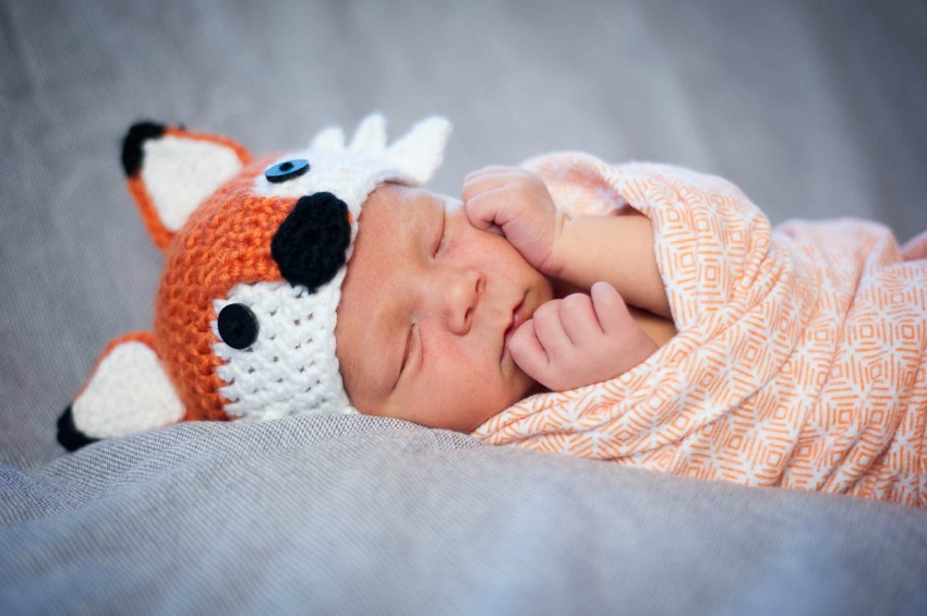 newborn Greyson in fox hat
