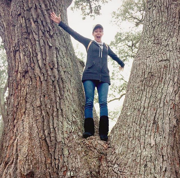 happy Jamie in a tree