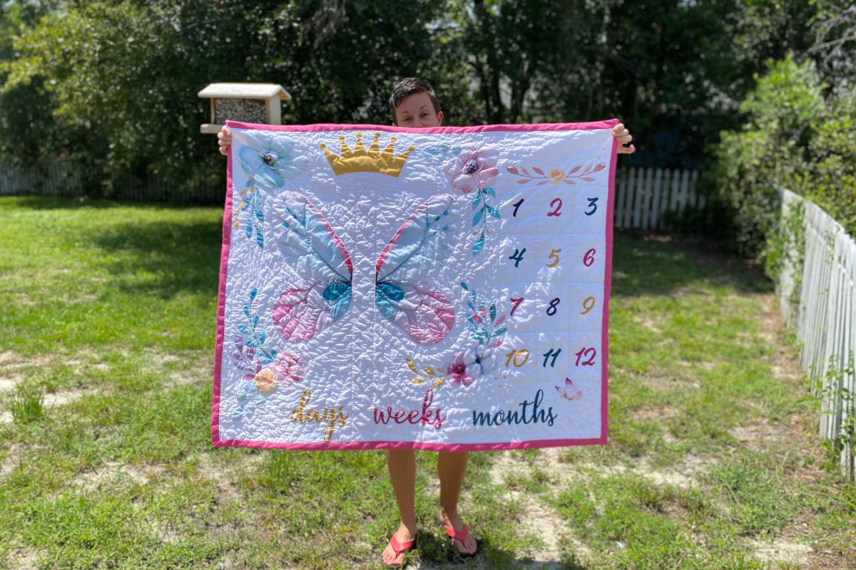 Butterfly crown floral hand stitched baby quilt