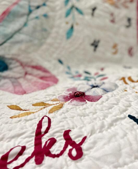 baby quilt hand stitching close-up